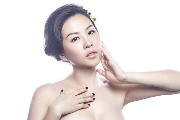 Hoa hậu Hoài Thu khoe eo thon với ảnh giả nude