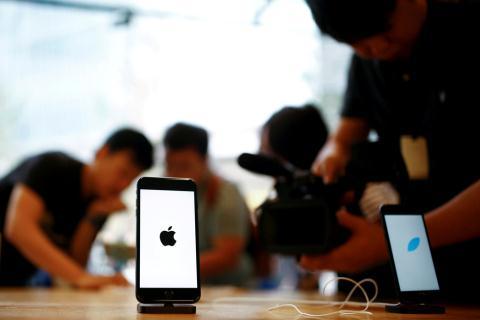 iPhone gap kho o Trung Quoc, Qualcomm quyet chien tai Duc